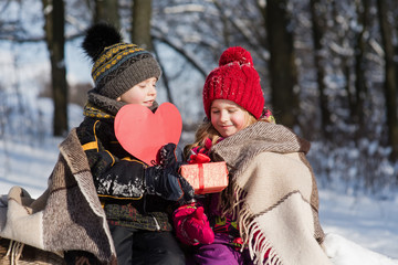 Kids with a gift and paper heart