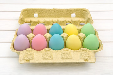 Colored Easter eggs in box decoration