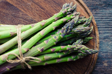 Bunch of asparagus on wooden board