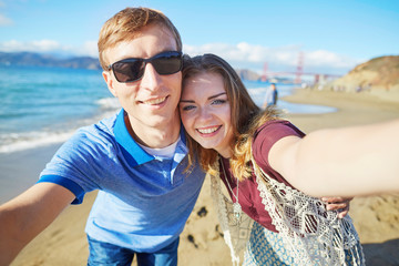 Couple taking selfie in San Francisco, USA
