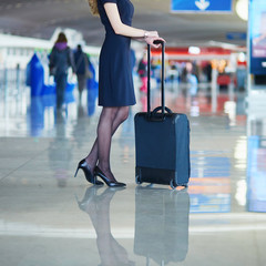 Passenger or flight attendant in international airport with hand luggage
