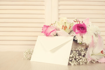 Basket of flowers and envelope