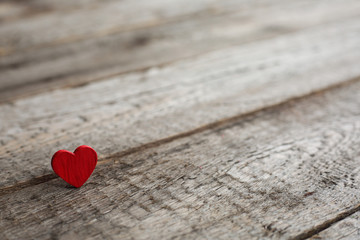 Small red heart on wood