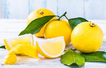 Fresh bergamot citrus fruits from Reggio Calabria Italy on white wood background.