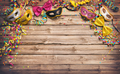 Colorful carnival or party frame of masks, streamers and confetti