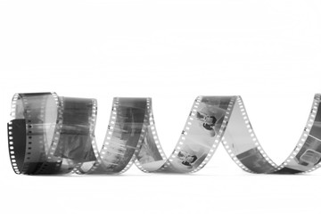 spiral of black and white negative film on white background
