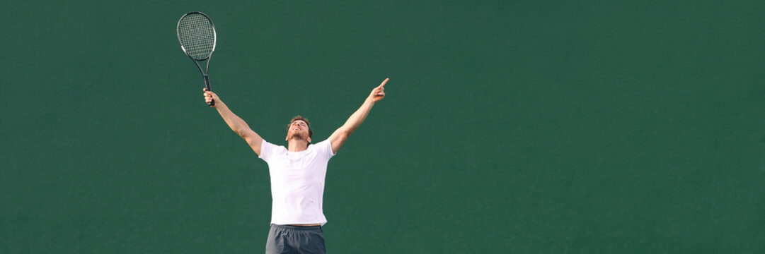 Tennis player man winning cheering celebrating victory in match point. Winner male athlete happy with arms up to the sky in celebration of success and win. Panoramic banner.