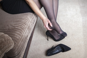 Tired businesswoman feet pain