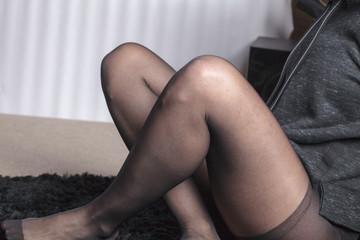 Sexy woman leg in tights seduction