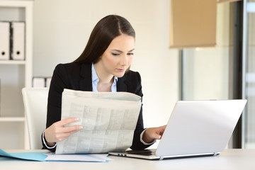 Businesswoman working reading a newspaper