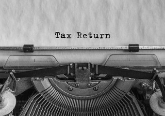 Tax Return, text typed on retro vintage typewriter. Close-up