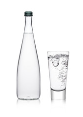 Bottle and glass with healthy still clear water