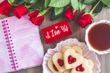 Jam filled Valentines Day heart cookies and tea