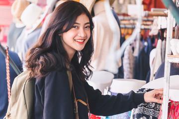 Asian woman tourist travel shopping walking on the street market
