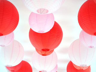 red and pink lanterns hanging on ceiling.