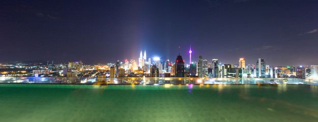 outdoor swimming pool and modern buildings at night
