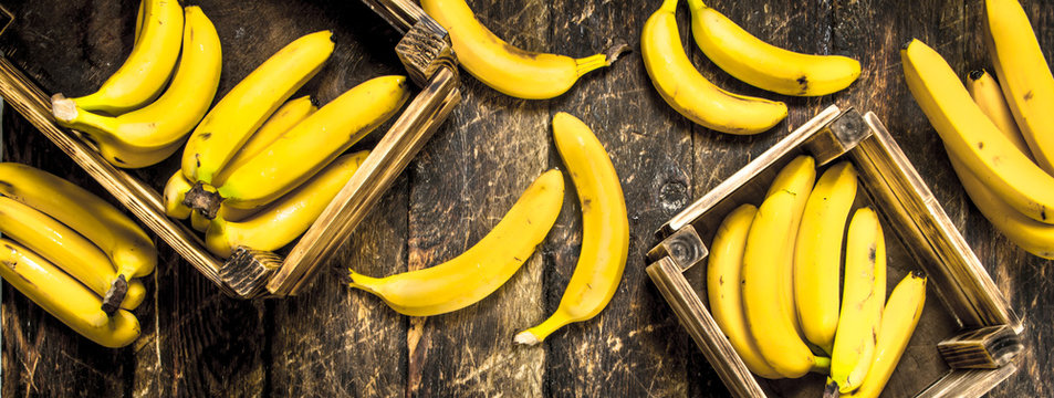 Fresh bananas in old boxes.