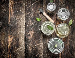 Food in tin cans with opener.