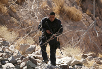 A Mexican policeman patrols as part of a joint operation to find Padilla in Ciudad Juarez