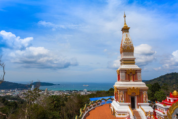 Beautiful pagoda of Thepnimit temple on high peak of Patong