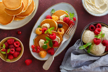 Pancake folded stack of fresh raspberries and mint