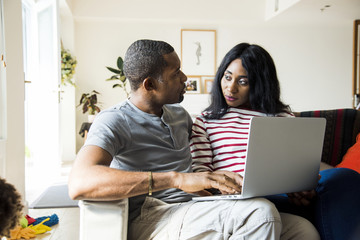 African couple working on laptop