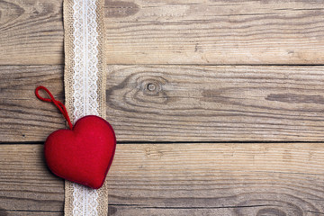 Rustic wooden background with sacking border andred  heart. Copy space.