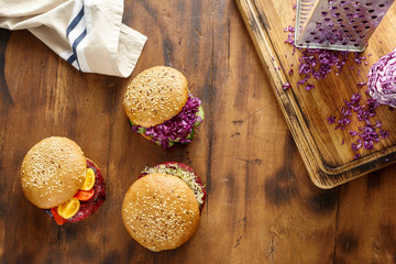 Set of different vegetarian burgers on wooden table