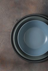 Empty plate on dark stone background. Top view