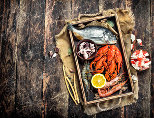 Seafood in an old tray.