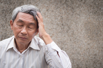 stressed hopeless senior old man suffering from chronic headache pain, migraine, stress, hangover