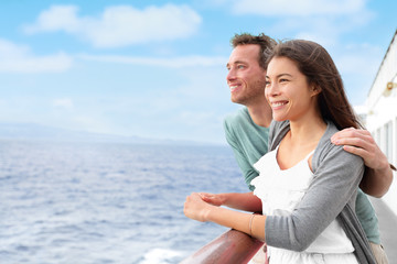 Happy interracial couple on cruise ship holiday