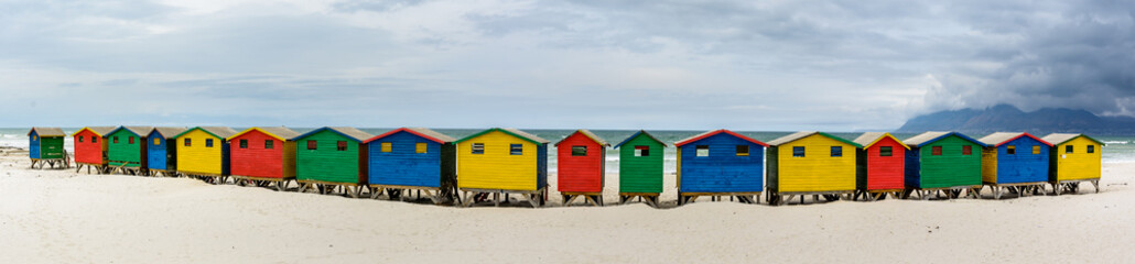 Ultra wide panorama of the colourful beach houses on Muizenberg beach - a popular tourist attraction near Cape Town, South Africa
