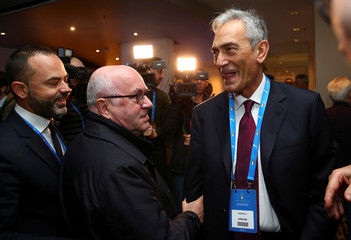 Former Italian Football Federation President (FIGC) Carlo Tavecchio (L) chats with Gabriele Gravina (R), one of the candidates, as they arrive at an election for the Italian Football Federation(FIGC) presidency in Rome