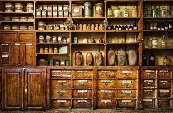 Bottles on the shelf in old pharmacy. Retro style.