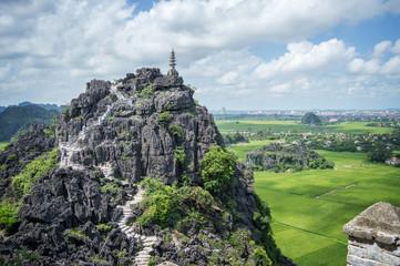 Top pagoda of Hang Mua temple, rice fields,  Ninh Binh, Vietnam