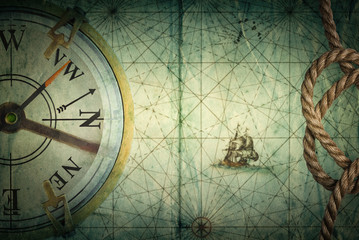 Fototapete - Compass on vintage map. Adventure, travel, stories background.