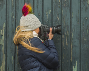 Woman photographer focused and taking picture