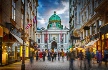 The pedestrian zone Herrengasse with a view towards imperial Hofburg palace in Vienna, Austria.