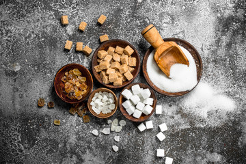Different kinds of sugar in bowls. Wall mural