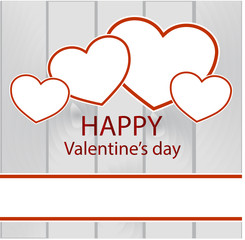 Valentine's Day background with hearts  on a wooden background