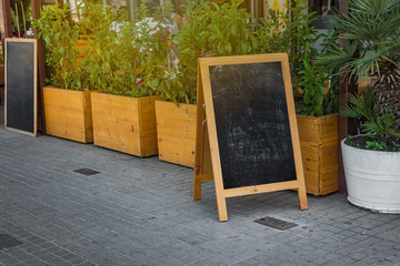 Street chalk board, outdoor stand, summer day
