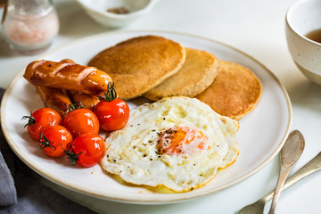 Pancakes with Fried egg, Sausages and Cherry Tomatoes