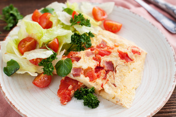 Spicy Omelet with ham, tomatoes, pepper, cheese and herbs