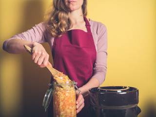 Young woman making kimchi