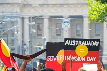 MELBOURNE, AUSTRALIA – JANUARY 26: Indigenous rights protesters marching in the CBD during the Invasion Day (Australia Day) Protests in Melbourne, Australia on January 26 2018.