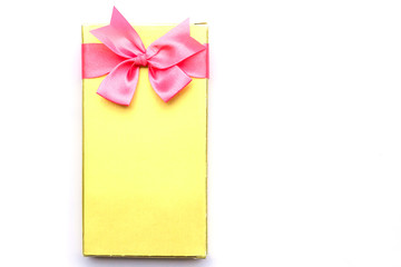 Gold gift on white background