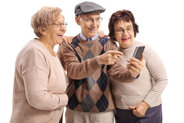 Elderly man showing something on a phone to two elderly women
