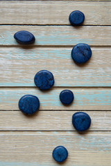 Blue decorative stones on a wooden background