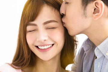closeup young asian couple kissing.